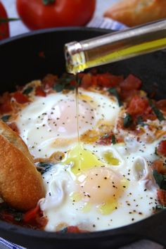 Italian Tomato and Eggs recipe- fresh tomatoes, basil and truffle oil makes this a simple, healthy & heavenly meal for breakfast or quick dinners. This is truly how Italians eat. http://www.thefedupfoodie.com