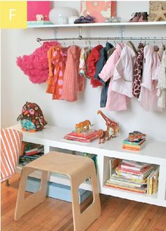 curtain rod on wall - love this idea. Kids clothes are so petite and cute, why not display them? Esp. if there is no closet. Love!