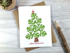 Hawaiian Christmas Card, Green Palm Leaf Holiday Card, Tropical Christmas Tree Card by craftedbylindy on Etsy https://www.etsy.com/listing/252049870/hawaiian-christmas-card-green-palm-leaf