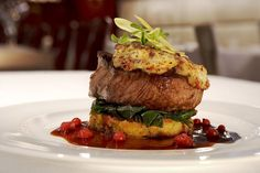 Elegantly plated dish of beef tenderloin, leafy greens, and  cranberry sauce: http://sothebysrealty.ca/blog/en/2016/07/20/from-wine-tours-to-safaris-a-72-hour-guide-to-niagara-falls-ontario/ #realestate #design #lifestyle