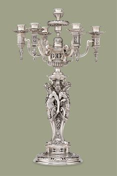 Classic architectural elements distinguish this pair of Puiforcat silverplated candelabra. The Puiforcat firm is legendary for its avant-garde designs. These Renaissance Revival candelabra are magnificent examples of Puiforcat craftsmanship. Pieces that bear the firm's mark are very desirable on the market ~ Antique Candlestick, 19th Century Decor, Decorating with Antiques ~ M.S. Rau Antiques