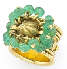 Rene Boivin ring in 18k gold with moving emerald beads c 1930's. An iconic piece, and  in  the Boivin book.