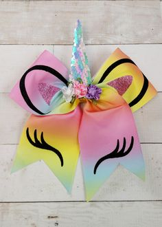 Details & Care Shipping/Returns Adorable rainbow pastel unicorn bow with sequin horn. Cheer style bow with tails, but an alligator clip backing so almost anyone can wear it! Each bow is made of Cute Cheer Bows, Cheer Hair Bows, Ribbon Hair Bows, Diy Hair Bows, Ribbon Flower, Fabric Flowers, Unique Hair Bows, Baby Girl Hair Bows, Cheerleading Bows