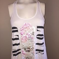 Express WILD LOVE  Race Back T Wild love sequins that mimic a by-the-shore feel. Pretty and bold. Loose and long. In good used condition, very slight signs of pilling. Express Tops Tank Tops