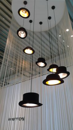 Beautiful cascading Jeeves and Wooster pendant lamps by Jake Phipps on the innermost exhibition stand in Milan, 2010