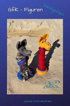 Giraffe und Wolf, mir der Nadel gefilzt, aus Schafwolle, in verschiedenen Ausführungen und Größen, auch individuell auf Bestellung nach Ihren genauen Vorstellungen.