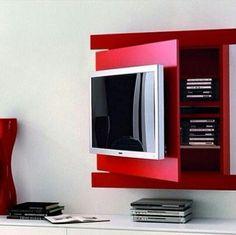 Mais uma dica para apartamentos pequenos. Esse painel de TV esconde um armário…