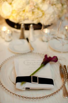 #place-settings  Planning: Imagine... Weddings and Special Events - imaginesb.com/ Floral + Event Design: Couture Flowers - coutureflowers.com Photography: The Youngrens - theyoungrens.com  Read More: http://www.stylemepretty.com/2011/12/30/new-years-wedding-by-the-youngrens/