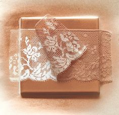 Again, holiday/wedding any kind of decorative tabletop need you may have!  These are ceramic tiles, you buy the color you want and a piece of interesting lace.  Spray adhesive holds the lace in place long enough for you to spray the tile with the contrasting color.