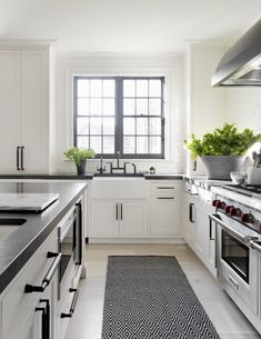 Modern kitchen white cabinets, kitchen black counter, black and grey kitche Refacing Kitchen Cabinets, White Kitchen Cabinets, Kitchen Cabinet Design, Kitchen Decor, Kitchen White, Dark Cabinets, Kitchen Ideas, Kitchen Hardware, Black Counter White Cabinets