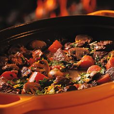 Beef, bacon, and vegetables simmer in a red wine sauce with a hint of citrus in this Slow-Cooked Provençal Beef Stew recipe for just 351 calories. #healthyrecipes #beefrecipes #healthyeating #everydayhealth | everydayhealth.com