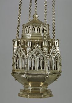 This is a Censer, it is a combination of both art and architecture. The top of it imitate Gothic art. It was done before It was made with silver that was gotten from Europe Art Essay, History Tattoos, American History Lessons, Gothic Art, 15th Century, Kirchen, Religious Art, Metropolitan Museum, Art And Architecture