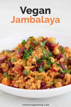 This simple vegan jambalaya is a super tasty, satisfying and nutritious vegan recipe, and a delicious dinner dish made with beans instead of meat. Jambalaya is a dish from Lousiana, which has its origins in the Tasty Vegetarian Recipes, Vegan Dinner Recipes, Veggie Recipes, Whole Food Recipes, Cooking Recipes, Healthy Recipes, Vegan Vegetarian, Vegetarian Main Dishes, Healthy Vegetarian Dinner Recipes