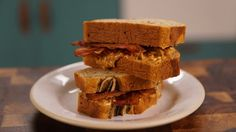 Recipe with video instructions: An Elvis sandwich on another level! Peanut butter, bacon and banana bread ... EPIC. Ingredients: 3 ripe bananas, chopped          , 2 eggs, 125g soft light brown sugar      , 125ml milk     , 275g plain flour, 1 tsp baking powder          , 100g butter, 4 rashers of bacon, 50g crunchy peanut butter + more for sandwich