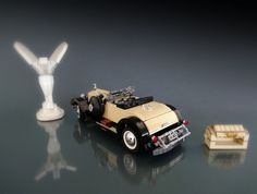 https://flic.kr/p/EnE2XH | Rolls Royce Springfield Silver Ghost Playboy Roadster | Built for Lugnets 100th challenge... www.flickr.com/groups/lugnuts/discuss/72157664118792946/  For more, please click the link below: www.moc-pages.com/moc.php/425751  Hello everyone, here's my newest model, a vintage car from a long time ago. This is my entry for a challenge for a group over Flickr called Lugnets, which in short you pick a number from 1-100 then the admins assign you a mission to build a car…