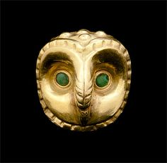 Moche culture - Bead in the form of an owl's head 100-800 AD - gold and turquoise. | Museo Tumbas Reales de Sipán, Lambayeque Photograph: Museo Tumbas Reales de Sipán