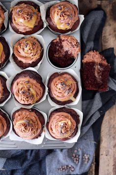 Chocolate cupcakes with a center of nutella, chocolate frosting and homemade salted caramel