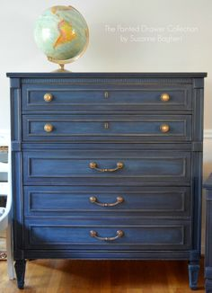 Refinish armoire and apothecary table - General Finishes Coastal Blue -- a true navy blue. On this set, I sanded the Coastal Blue back to create an almost denim look. As you see, it pairs very well with brass or gold hardware.