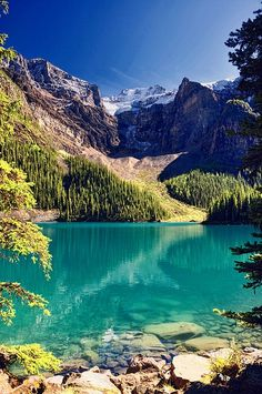 Moraine Lake is a glacially-fed lake in Banff National Park, 14 kilometres (8.7 mi) outside the Village of Lake Louise, Alberta, Canada