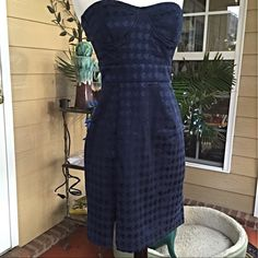Dress 2XHP 1/14by roxyjane 1/22 by Larochelle This adorable strapless, navy dress has a textured pattern in the fabric. The bra is structured and lined and it is 29 inches long. Lycra and polyester give it some stretch while it hugs the body in a beautiful fit. Really cute Forever 21 Dresses