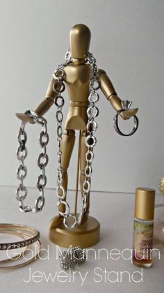 Gold mannequin jewelry stand