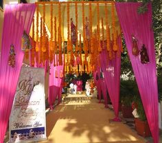 orange and pink rajasthani bhaat ceremony decor, mehendi decor, traditional