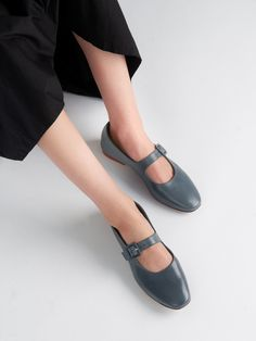 These flats are designed in a round-toe silhouette, detailed with a decorative Mary Jane strap and set on moderate leather heel. A perfect style that is inspired from the comfort of the dreamy past but look just as contemporary for the hype of this season. Leather Design, Vegetable Tanned Leather, Leather Heels, Mary Janes, Ballet Flats, Blue Denim, Toe, Silhouette, Contemporary