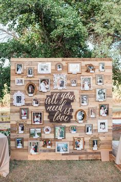 """This display proves your favorite song isn't just for the first dance: The couple incorporated the lyrisc from the Beatle's """"All You Need Is Love"""" on their photo backdrop."""