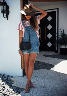 Denim overalls and striped top, summer fashion trends.