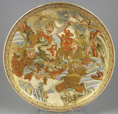 Meiji Period Satsuma Low Bowl with decoration of a battle scene between humans and ape men.