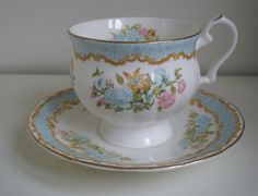 "Royal Canterbury""Warwick"",Tea Cup and Saucer,Floral Footed Cup,Made in England, Fine Bone China, Blue and Pink Roses, Gold Rim."