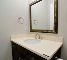 @Cambria Cuddington bathroom countertop by Atlanta Kitchen and framed mirror from Atlanta Glass & Mirror