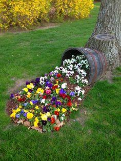 Spilled flower wine barrel planter #diy #winebarrel #flowerplanter #repurpose #decorhomeideas