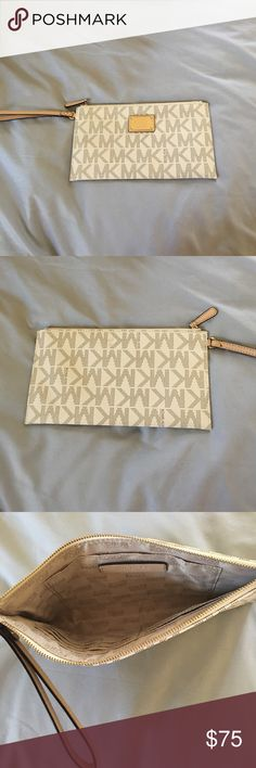 NWOT Michael Kors Envelope Wristlet, Vanilla Never used. Approx 10Lx5.5H Michael Kors Bags Clutches & Wristlets