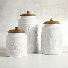 Whether you live in the city or in the country, our farmhouse-style canisters are the cream of the crop. Plant them on a countertop and reap the compliments. Each features a carved mango wood handled lid.