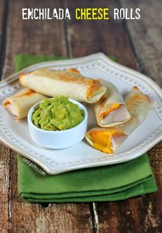 Enchilada Cheese Rolls - beans, cheese and sauce all wrapped up in an egg roll wrapper. These are addicting and just 105 calories or 3 Weight Watchers SmartPoints each! Perfect as an appetizer or snack. www.emilybites.com