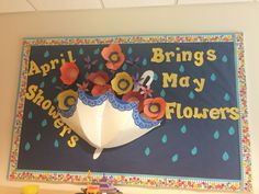 """April showers bring May flowers"" spring classroom bulletin board. Paper poppies and daffodils. Birthday Bulletin Boards, Spring Bulletin Boards, Classroom Bulletin Boards, Classroom Crafts, Classroom Door, Board Decoration, Class Decoration, Paper Umbrellas, Preschool Bulletin Boards"
