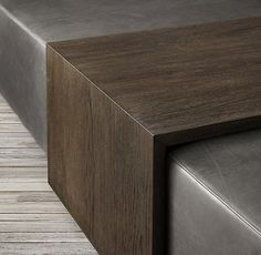 RH's Bridge Leather Coffee Table Ottoman:Embodying the Modernist design ethos of form follows function, our multipurpose ottoman by the Van Thiels is equal parts elegant and efficient. The seat–low profile and crisply tailored–is unadorned but for a movable oak tray to keep books and drinks close at hand. Bridging the three sides, it seamlessly merges with the sleek silhouette.
