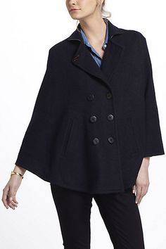 A wool cape is a very chic alternative to a coat-and odds are you won't see anyone else wearing one!