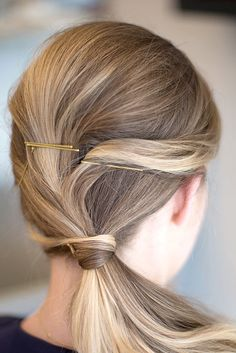 Give your side pony more volume by teasing and pinning the hair at your crown first.