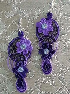 Layered ornate paper quilled earrings. Brought to you by Occasions Gifting Solutions.