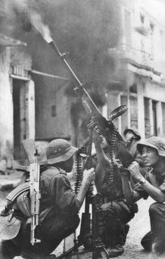 National Liberation Front Vietnam | Members of the Vietnam National Liberation Front (Vietcong) fire a ...