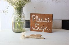"""rustic wedding """"please sign"""" signage . selfstanding guest book sign . antique white letters . by montanasnow"""