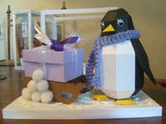 """""""Pogo"""" the Penguin with knitted scarf by Maxine Simpson, using a card making template from Card Carousel. Card Making Templates, 3d Cards, Display Boxes, Carousel, Penguin, Making Ideas, Cardmaking, Paper Crafts, Gallery"""