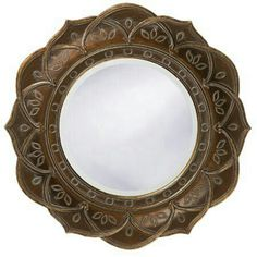 Morrocan mirror. I would repaint it to be brighter gold though, and so the pattern isn't as visible.