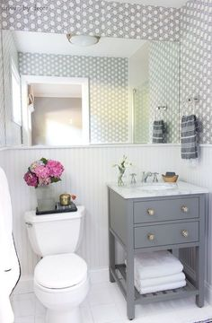 In this post: One of my favorite small bathroom makeovers ever! With just a few simple changes, this guest bathroom makeover made a night and day difference to our space! Read on for lots of Small Bathroom Vanities, Bathroom Design Small, Bathroom Renos, Bathroom Renovations, Bathroom Interior, Bathroom Storage, Bathroom Ideas, Small Vanity, Bathroom Cabinets