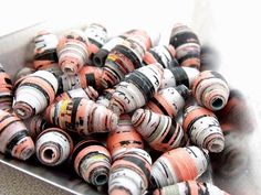 by Wicked Red hand rolled paper beads peach and black. www.bywickedred.com