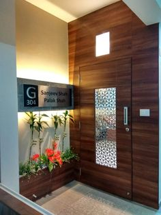Main entrance: interior landscaping by less is more -architects & interior designer House Main Door Design, Wooden Front Door Design, Main Entrance Door Design, Home Entrance Decor, Room Door Design, Door Design Interior, Foyer Design, Lobby Design, House Entrance