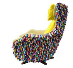 This re-upholstered chair has been decorated with colourful charms considered to be lucky in Brazil.