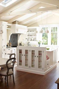 white kitchen / island with bench